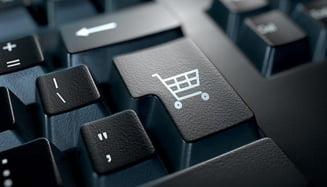 Hainele si electronicele, preferatele cumparatorilor online din Romania