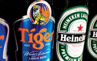 Heineken, in lupta stransa pentru a cumpara berea Tiger