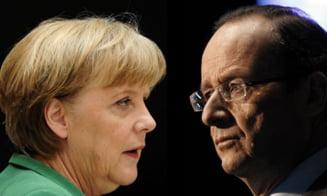 Hollande: Criza este in urma noastra. Merkel: Nu pot sa ridic starea de alerta