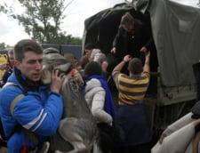 Inundatiile din Balcani ameninta o centrala din Serbia si zonele minate din Bosnia