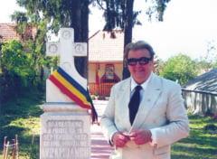 Iohannis a trimis o coroana de flori la sicriul lui Vadim Tudor