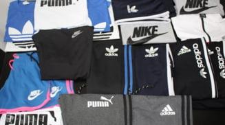 Jandarmii olteni au confiscat haine contrafacute din balciul de la Ipotesti