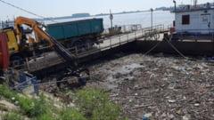 La Galati, Dunarea e plina de gunoaie aduse de inundatii (FOTO)