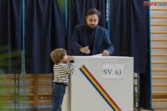 La sectia de votare din Basel voteaza si copiii