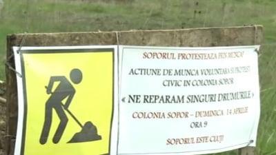 Locuitorii unei strazi din Cluj-Napoca si-au asfaltat singuri strada