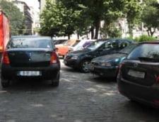 Masinile de firma sau luate in leasing nu mai au voie sa parcheze in fata blocului