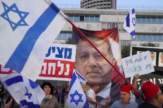 Mii de israelieni au protestat fata de incercarea lui Netanyahu de a-si asigura imunitatea in fata justitiei