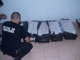 Mii de pachete cu tigari, ascunse sub vagoane, confiscate la vama Moravita