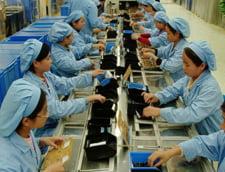 Muncitorii din fabricile romanesti au aceleasi salarii ca cei din China