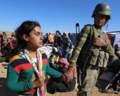 Noi dezvaluiri despre Statul Islamic: Copii rapiti, torturati si indoctrinati