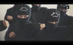 Nou clip socant al Statului Islamic: Un copil decapiteaza un ostatic si ameninta America in engleza