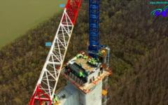 O noua operatiune impresionanta la podul suspendat peste Dunare. Constructorii japonezi pregatesc intinderea cablurilor principale VIDEO
