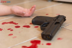 O politista aflata in concediu de maternitate si-ar fi impuscat mortal bebelusul si mama, apoi s-ar fi sinucis