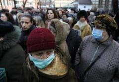 OMS: Abia peste un an-doi vom putea spune ca am scapat de gripa porcina