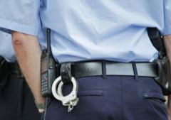 Ofiter de politie din Reghin, retinut pentru trafic de influenta si santaj de procurorii DNA