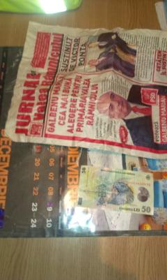PDL acuza: 50 de lei ascunsi in ziare pentru a vota candidatul PSD
