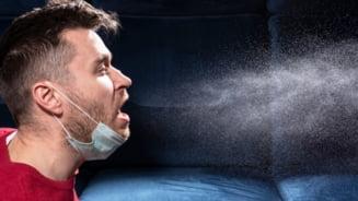 """Particulele de coronavirus din saliva pot parcurge peste 5 metri in conditii de """"briza usoara"""""""