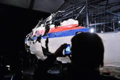 Patru barbati au fost inculpati pentru doborarea avionului MH17 in Ucraina