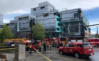 Patru morti si patru raniti dupa ce o macara a cazut peste sase masini in centrul orasului Seattle (Foto&Video)