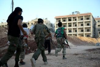 Pentagonul confirma: 70 de rebeli antrenati de militari americani au ajuns in Siria