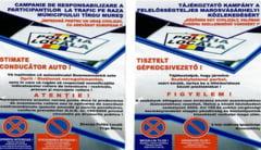 Politia pune fluturasi bilingvi pe masinile parcate ilegal in Targu Mures