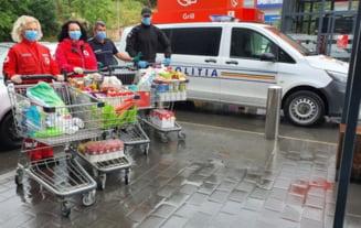 Politistii olteni au dus alimente familiilor nevoiase din Slatina
