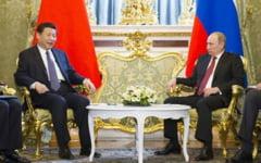 Presedintele Chinei ridica in slavi relatiile excelente cu Putin si e nemultumit de Trump