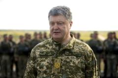 Presedintele Porosenko sustine ca Rusia mobilizeaza trupe la granita cu Ucraina si ca exista riscul unui razboi total
