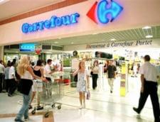 Profiturile Carrefour s-au redus cu aproape jumatate