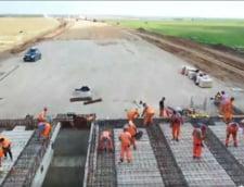 Progrese spectaculoase pe Drumul Expres Craiova-Pitesti si la noul pod peste Olt. Tronsonul de 40 de kilometri ar putea fi gata la sfarsitul acestui an VIDEO