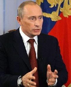 Putin nu foloseste telefonul mobil si tine pozele in portofel