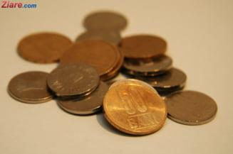 Rata unui credit in franci elvetieni achitata cu sapte kilograme de monede