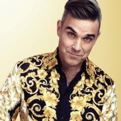 Robbie Williams a fost diagnosticat cu COVID-19. Artistul este izolat intr-o vila de lux