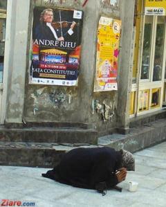 Romanca amendata in Austria cu 38.000 de euro pentru ca cersea cu un copil