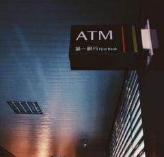 Romani infractori in Taiwan: Au furat din bancomate milioane de dolari