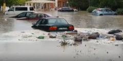 Romania inundata: Apa de peste un metru pe un drum national, Bucurestiul s-a transformat in lac (Foto & Video)