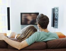 Romanii, europenii care petrec cel mai mult timp la TV