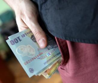 Romanii vor scoate mai multi bani din buzunar cand merg la cumparaturi