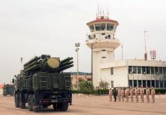 Rusia anunta ca a respins zeci de atacuri cu rachete si drone asupra bazei sale aeriene din Siria