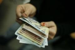 Salariul minim ar putea creste la 700 de lei