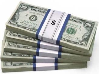 Salvarea dolarului ingroapa economia SUA