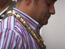Scandal cu pistoale la petrecerea rromilor de la Costesti: Un barbat a fost retinut