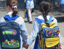 Se intorc uniformele scolare? - Proiectul de lege, avizat de Guvern