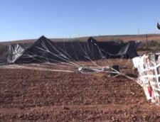 Statul Islamic sustine ca a capturat arme parasutate de avioanele americane (Video)
