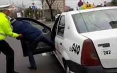 Taximetrist amenintat cu un pistol de un tanar de 21 de ani