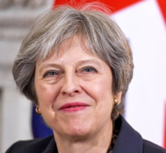 Theresa May vrea ca Brexit-ul sa tina doi ani, o parte din Partidul Conservator incearca s-o demita. Va supravietui?