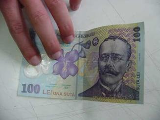 Trei tineri care cumparau alimente cu bancnote falsificate, arestati la Husi