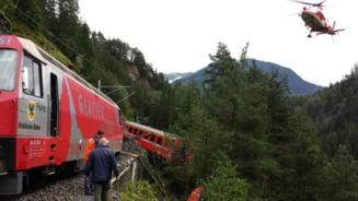 Tren cu 200 de pasageri deraiat in Elvetia: 2 vagoane, in prapastie