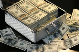 UPDATE Firma romaneasca, suspectata ca a spalat 500.000 de dolari proveniti din escrocherii financiare comise in strainatate