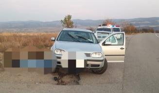 Ucis de masina in care incerca sa urce